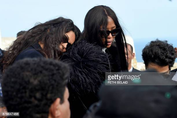 TunisianItalian model Afef Jnifen and British model Naomi Campbell mourn as they attend the funeral of the late Tunisian fashion designer Azzedine...