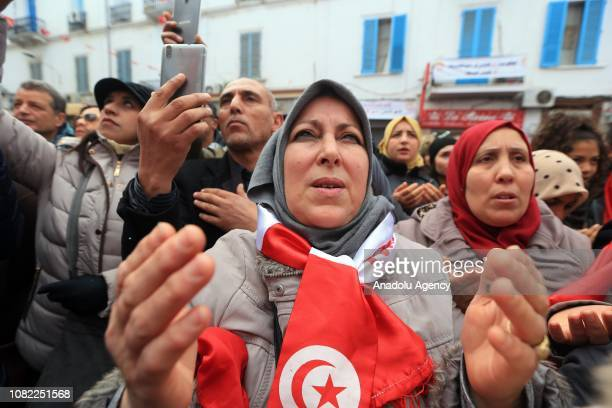 Tunisians attend a rally marking the eighth anniversary of Arab Spring in front of the headquarter of the Tunisian General Labour Union in the...