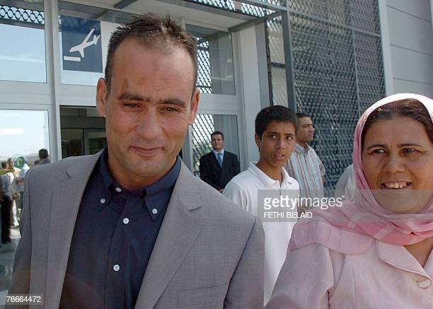 Tunisian's fisherman Lassaad Gharrad smiles next to his mother upon his arrival 11 September 2008 at the Tunis-Carthage airport after being released...