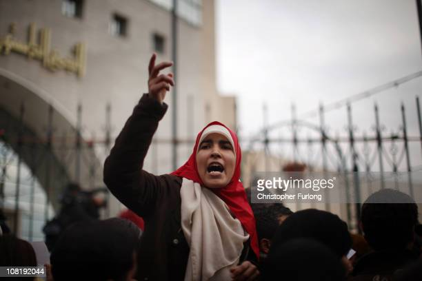 Tunisians protest outside the Constitutional Democratic Rally party headquarters for changes in Tunisia's new government on January 20 2011 in Tunis...