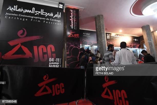 Tunisians queue in front of a movie theater on November 8 2017 in Tunis during the 28th edition of the Cinematographic Days of Carthage JCC AFP FETHI...