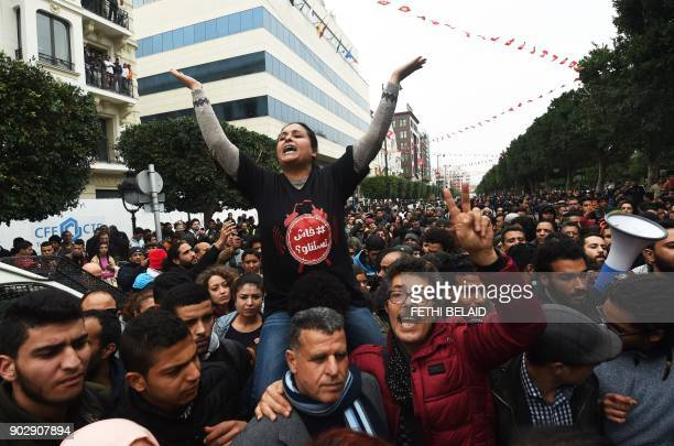 TOPSHOT Tunisians shout slogans during a demonstration against the government and price hikes on January 9 2018 in Tunis Protests hit several parts...