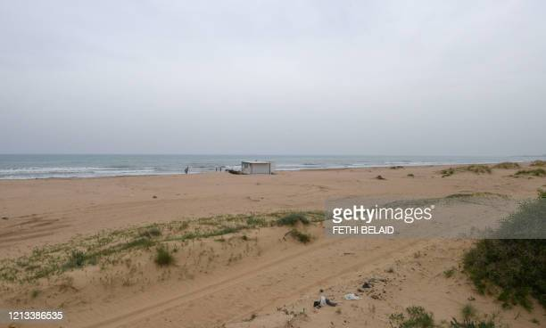 Tunisians spend time at the beach in Gammarth on the outskirts of the capital Tunis on May 16 amid the COVID19 pandemic Although the North African...