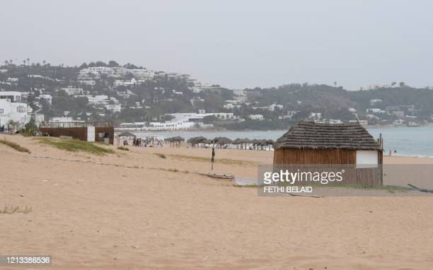 Tunisians spend time at the beach in La Marsa on the outskirts of the capital Tunis on May 16 amid the COVID19 pandemic Although the North African...