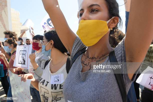 Tunisians take part in a protest, part of the Hassebhom campaign, which translate to Hold Them Accountable, outside the Parliament headquarters in...