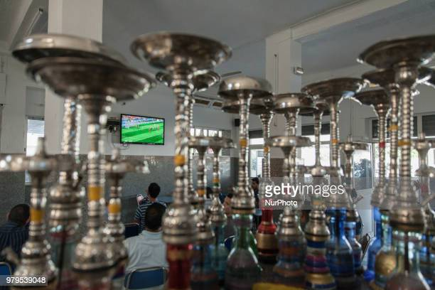 Tunisians watch the FIFA World Cup 2018 group B preliminary round soccer match between Portugal and Morocco at a cafe in Ariana City northeastern...
