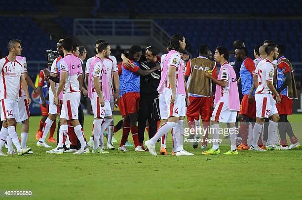 Tunisia's and Congo's players celebrate each other as the 2015 African Cup of Nations Group B soccer match between Tunisia and Congo finishes at Bata...
