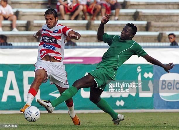 Tunisia's Club Africain striker Borhane Ghanem vies with Mali's Djoliba AC forward Fane Lassana during an African Cup Confederation football match on...