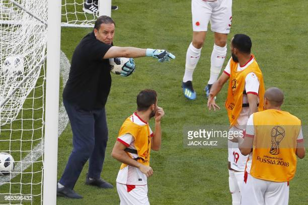 Tunisia's coach Nabil Maaloul gestures as he trains as a goalkeeper with Tunisia's forward Saber Khalifa and teammates during a training session at...