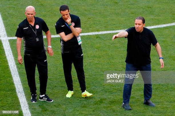 Tunisia's coach Nabil Maaloul gestures past his coach assistants during a training session at the Mordovia Arena in Saransk on June 27 on the eve of...