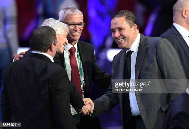 Tunisia's coach Nabil Maaloul shakes hands with Columbia's national football team coach Jose Pekerman next to Egypt's Argentinian coach Hector Cuper...