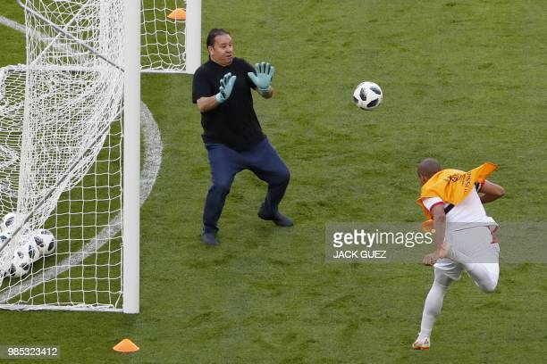 Tunisia's coach Nabil Maaloul trains as a goalkeeper during a training session at the Mordovia Arena in Saransk on June 27 on the eve of their Russia...