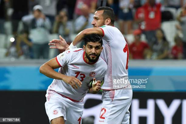 Tunisia's defender Ali Maaloul congratulates Tunisia's midfielder Ferjani Sassi for his goal during the Russia 2018 World Cup Group G football match...