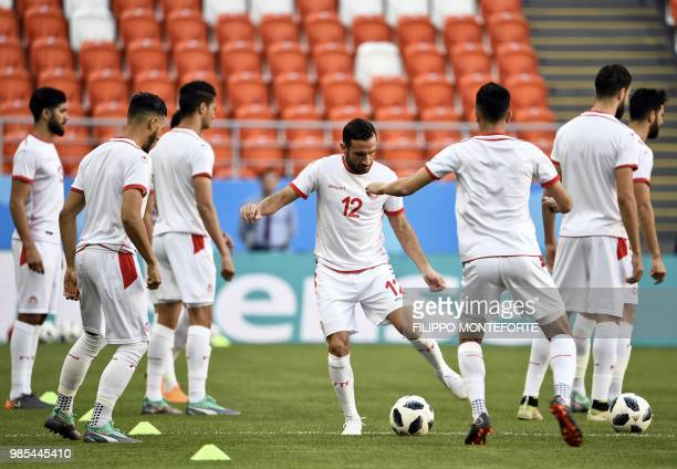 Tunisia's defender Ali Maaloul controls a ball past teammates during a training session at the Mordovia Arena in Saransk on June 27 on the eve of the...