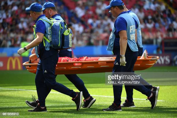 Tunisia's defender Dylan Bronn is carried on a stretcher after resulting injured during the Russia 2018 World Cup Group G football match between...