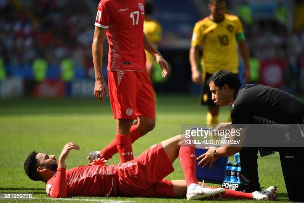 Tunisia's defender Dylan Bronn lies in the field after resulting injured during the Russia 2018 World Cup Group G football match between Belgium and...