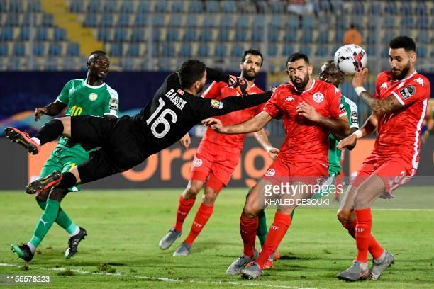 Tunisia's defender Dylan Bronn scores an own goal during the 2019 Africa Cup of Nations Semi-final football match between Senegal and Tunisia at the...