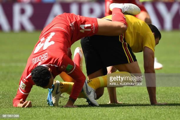 TOPSHOT Tunisia's defender Dylan Bronn vies with Belgium's defender Jan Vertonghen during the Russia 2018 World Cup Group G football match between...