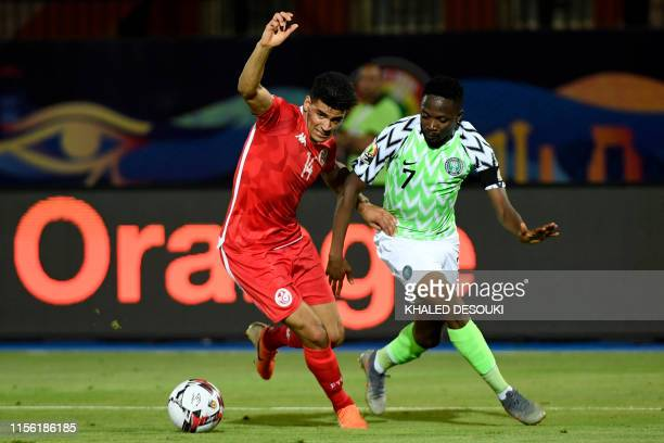 Tunisia's defender Mohamed Drager vies for the ball with Nigeria's forward Ahmed Musa during the 2019 Africa Cup of Nations third place play-off...