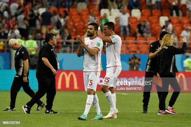 Tunisia's defender Oussama Haddadi and Tunisia's midfielder Ahmed Khalil celebrate at the end of the Russia 2018 World Cup Group G football match...