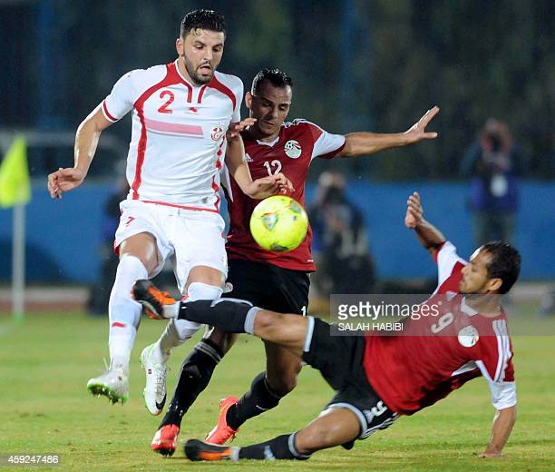 Tunisia's defender Siame Ben Youssef vies with Egyptian forward Walid Sliman and Khaled Kmar during the 2015 Africa Cup of Nations qualifying...