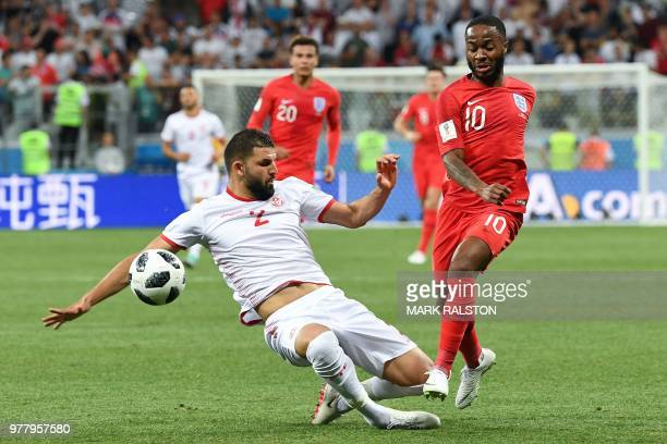 Tunisia's defender Syam Ben Youssef vies with England's forward Raheem Sterling during the Russia 2018 World Cup Group G football match between...