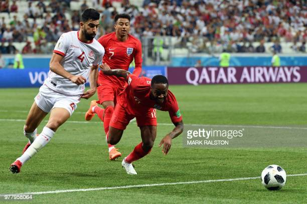 Tunisia's defender Yassin Meriah vies with England's forward Raheem Sterling during the Russia 2018 World Cup Group G football match between Tunisia...