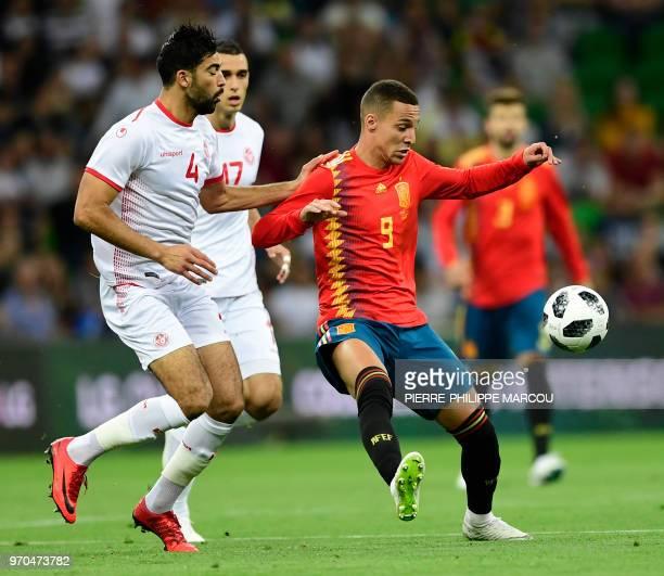 Tunisia's defender Yessine Meriah vies with Spain's forward Rodrigo during the friendly football match between Spain and Tunisia at Krasnodar's...