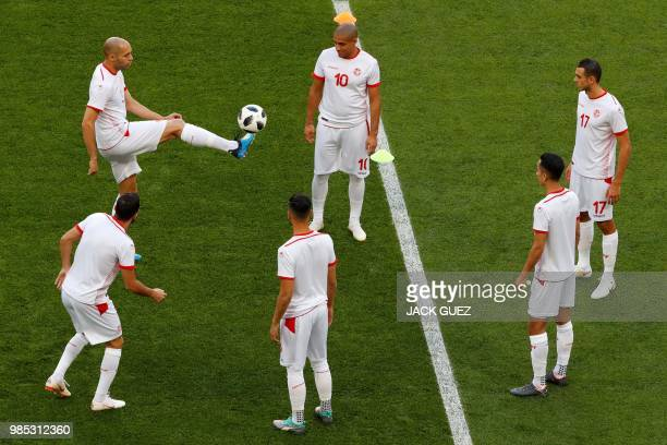 Tunisia's defender Yohan Benalouane controls the ball past teammates during a training session at the Mordovia Arena in Saransk on June 27 on the eve...