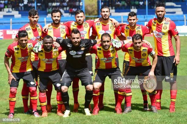 Tunisia's Esperance sportive de Tunis players goalkeeper Moez Ben Cherifia Ivorian midfielder Fousseny Coulibaly Chamseddine Dhaouadi Bilel Mejri...