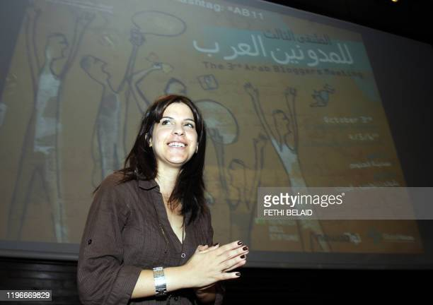 Tunisia's famous blogger Lina Ben Mhenni who has been tipped for the 2011 Nobel Peace Prize nominations gestures during the third Arab Bloggers...