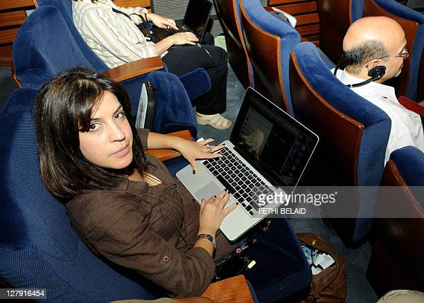 Tunisia's famous blogger Lina Ben Mhenni who has been tipped for the 2011 Nobel Peace Prize nominations works on her computer during the third Arab...