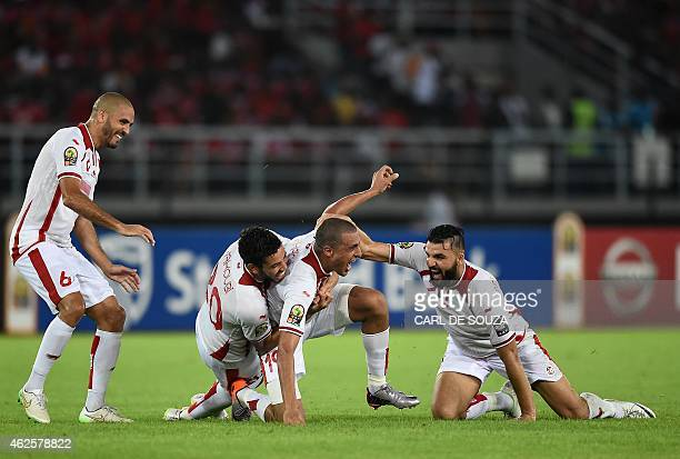 Tunisia's forward Ahmed Akaichi celebrates with teammates after scoring a goal during the 2015 African Cup of Nations quarterfinal football match...