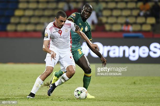 Tunisia's forward Ahmed Akaichi challenges Senegal's defender Kalidou Koulibaly during the 2017 Africa Cup of Nations group B football match between...
