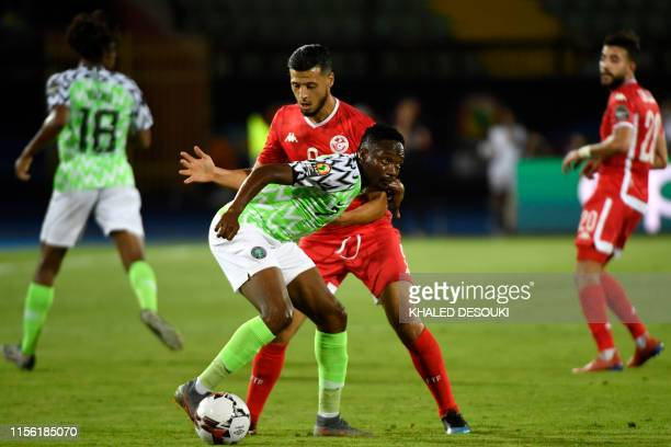 Tunisia's forward Anice Badri fights for the ball with Nigeria's forward Ahmed Musa during the 2019 Africa Cup of Nations third place play-off...