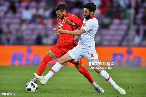 Tunisia's forward Anice Badri vies with Turkey's midfielder Mahmut Tekdemir during the friendly football match Tunisia vs Turkey at the Stade de...
