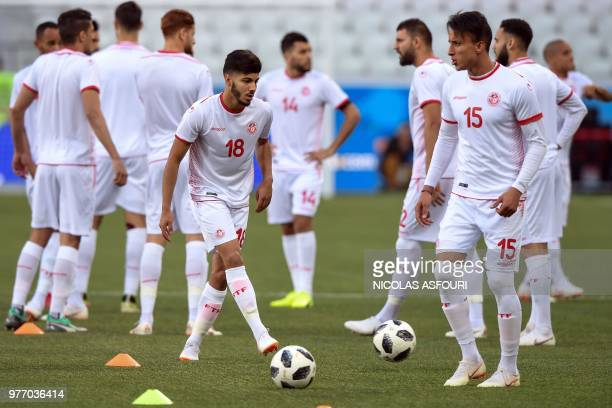 Tunisia's forward Bassem Srarfi Tunisia's midfielder Ahmed Khalil and teammates attend a training session at the Volgograd Arena in Volgograd on June...
