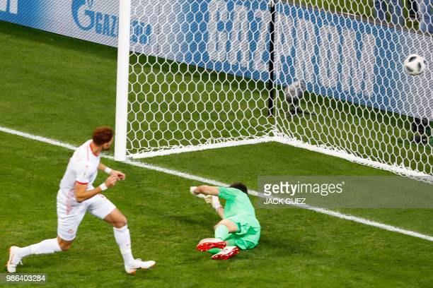 Tunisia's forward Fakhreddine Ben Youssef scores against Panama's goalkeeper Jaime Penedo during the Russia 2018 World Cup Group G football match...