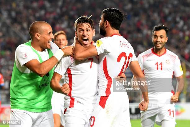 Tunisia's forward Ghaylene Chaalali celebrates with Youssef Msakni and other teammates after scoring a goal during the World Cup 2018 qualifying...