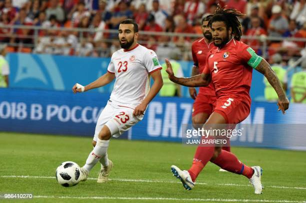 Tunisia's forward Naim Sliti vies with Panama's defender Roman Torres during the Russia 2018 World Cup Group G football match between Panama and...