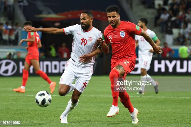 Tunisia's forward Saber Khalifa vies with England's defender Kyle Walker during the Russia 2018 World Cup Group G football match between Tunisia and...