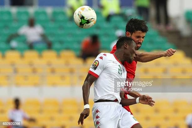 Tunisia's forward Taha Yassine Khenissi heads the ball with Burkina Faso's midfielder Cyrille Bayala during the 2017 Africa Cup of Nations...