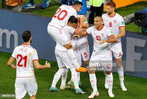 Tunisia's forward Wahbi Khazri celebrates with teammates after scoring during the Russia 2018 World Cup Group G football match between Panama and...