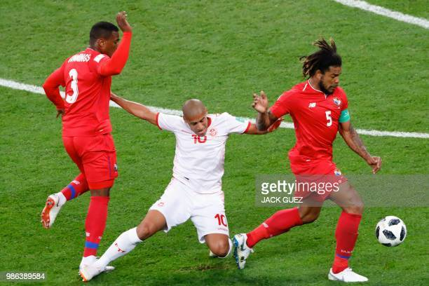 Tunisia's forward Wahbi Khazri fights for the ball with Panama's defender Harold Cummings and Panama's defender Roman Torres during the Russia 2018...