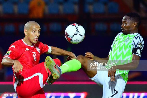Tunisia's forward Wahbi Khazri vies for the ball with Nigeria's forward Ahmed Musa during the 2019 Africa Cup of Nations third place play-off...