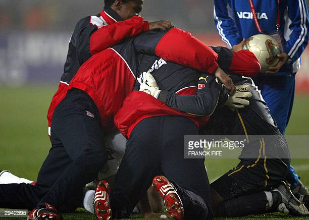 Tunisia's Goalkeaper Ali Boumnijel is congratuled by teammates after their quarterfinal match in the African Nations Cup in stadium in Rades 07...