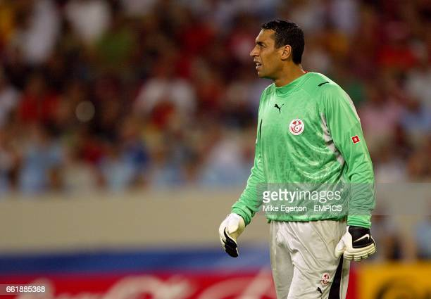 Tunisia's goalkeeper Ali Boumnijel stands dejected after conceding the equalising goal scored by Spain's Raul