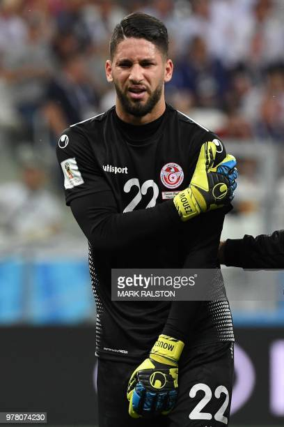 Tunisia's goalkeeper Mouez Hassen touches his shoulder as he leaves the pitch after resulting injured during the Russia 2018 World Cup Group G...