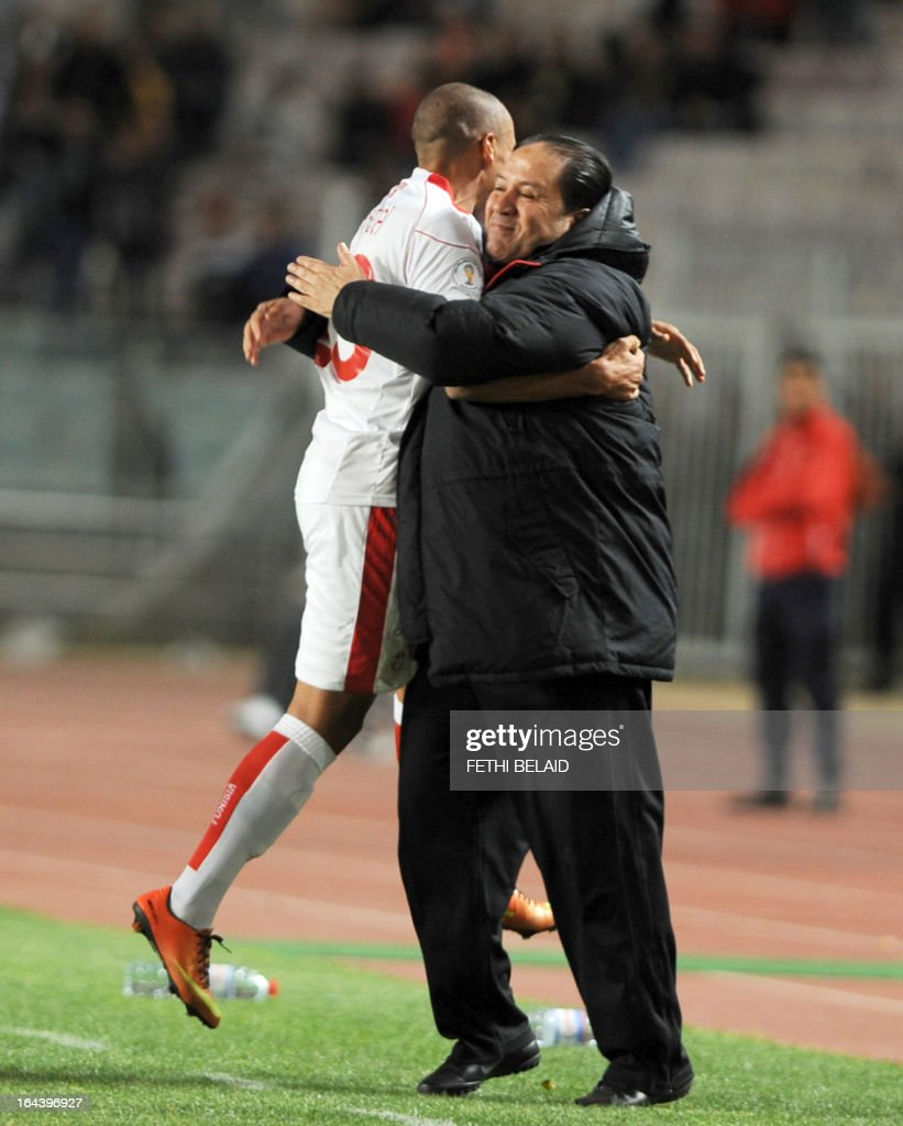 Tunisia's head coach Nabil Maaloul celebrates with Tunisia's Wahbi Kharzi during their FIFA 2014 World Cup qualifying match against Sierra Leone on March 23, 2013 at the Rades stadium in Tunis. Tunisia won 2-1.