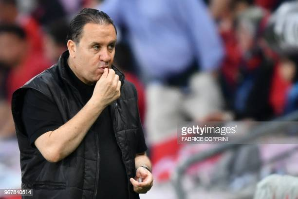 Tunisia's head coach Nabil Maaloul eats dates during the friendly football match between Tunisia and Turkey at the Stade de Geneve stadium in Geneva...